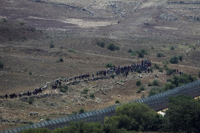 Israel warns Syrians away from frontier as Assad closes in