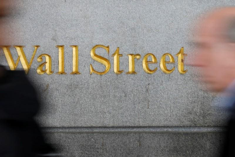 Wall Street climbs on Powell comments, earnings