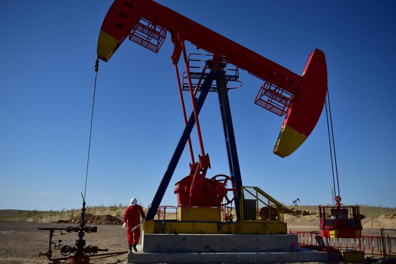 Oil prices fall; Brent still set for weekly gain