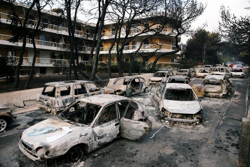 PM's words mean little to fire-stricken Greeks standing on ashes