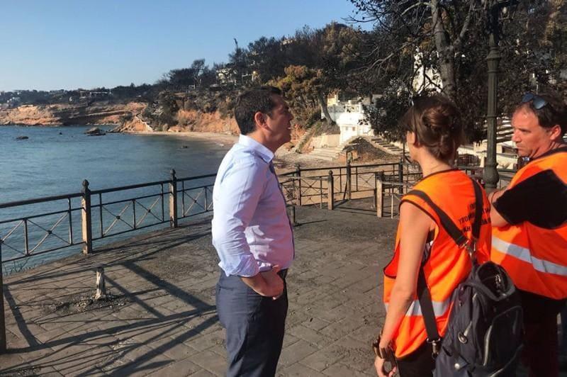 Greek PM meets survivors in fire-stricken town after criticism