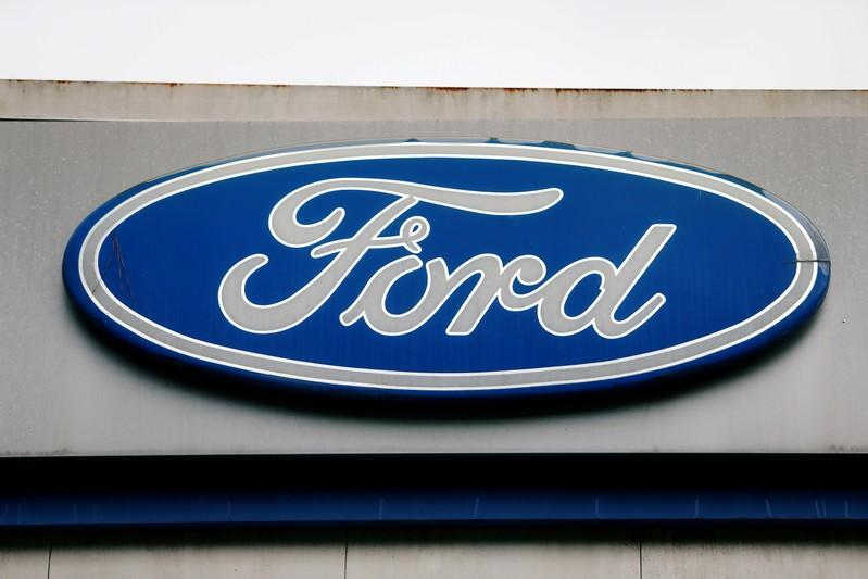 Ford profit hit by restructuring, gives low 19 forecast