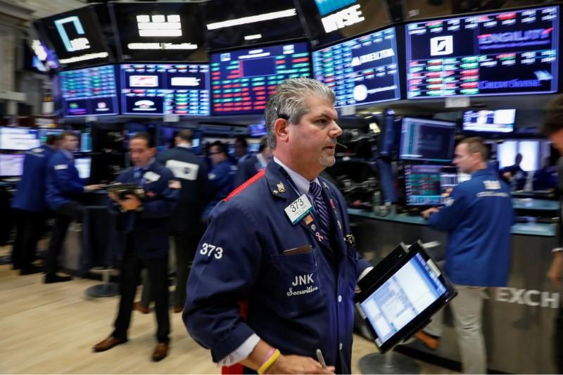 Nasdaq hit as chip stocks fall; defensive sectors prop up Dow, S&P