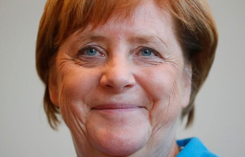 Merkel says don't expect much from meeting with Putin