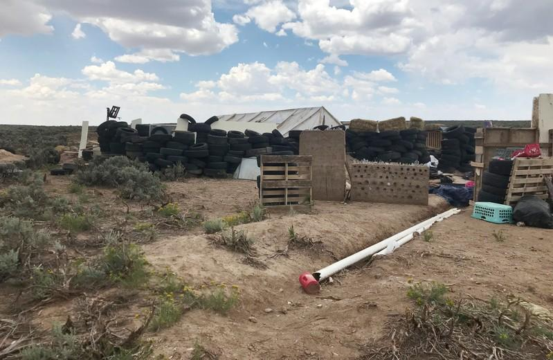 Trailer at New Mexico compound had been stolen in  Alabama: police