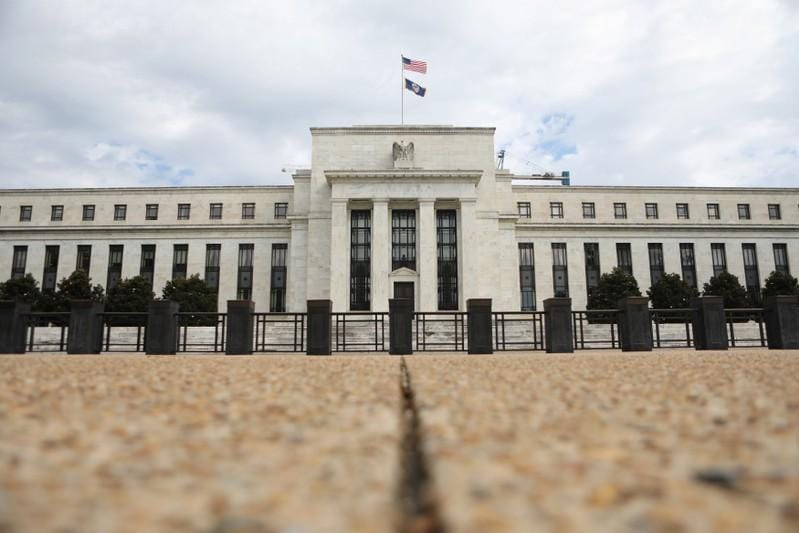 Fed policymakers see rate hikes, blurring dove-hawk divide