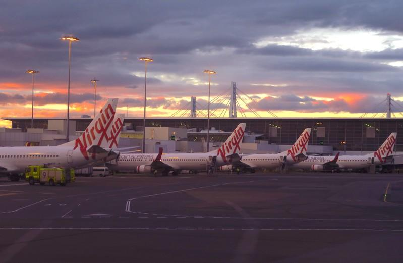 Virgin Australia to merge units cut jobs as it swings to FY loss