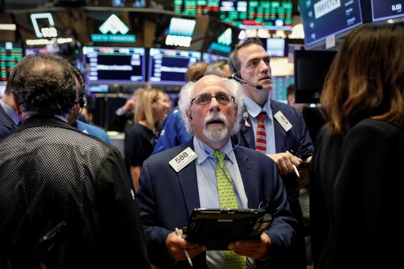 Stock markets fall on trade war pessimism; oil rallies