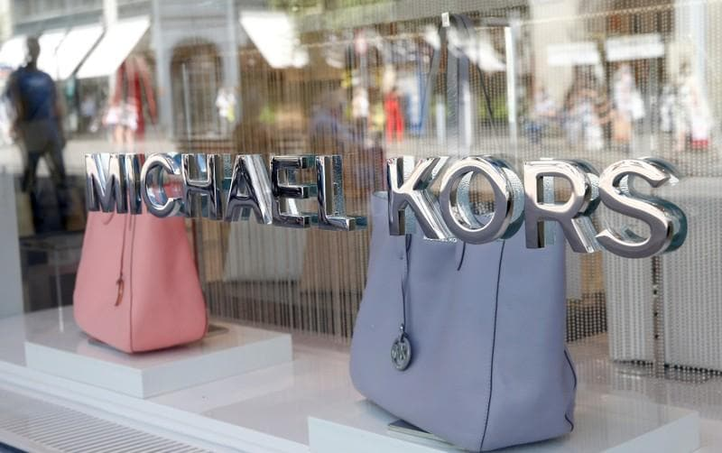 Michael Kors makes high-end fashion statement with $2.2 billion Versace buy