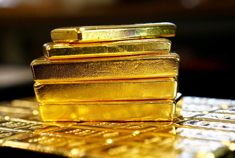 Gold inches down as dollar firms; Fed in focus