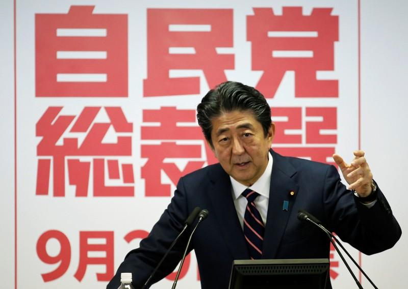 Japan PM Abe to keep key ministers in posts in cabinet reshuffle