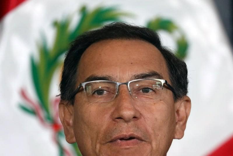 Support for Peru's president surges after battle with Congress