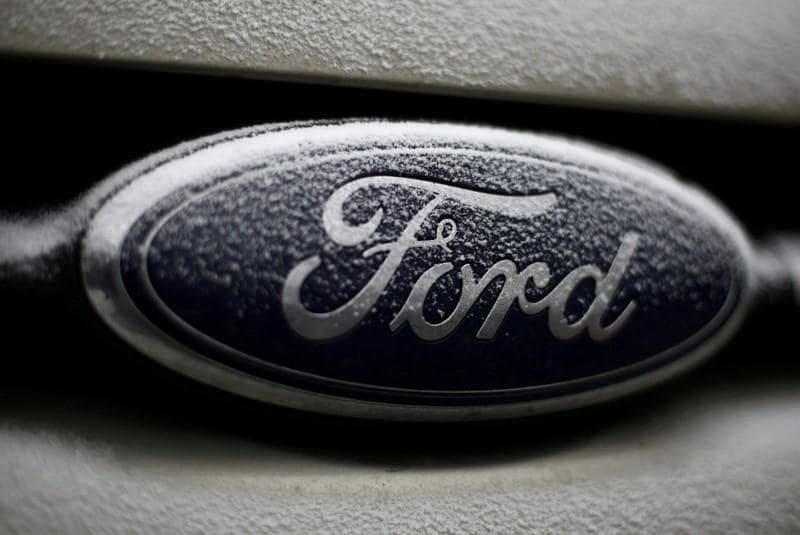 China slump, commodity costs cause Ford profit drop
