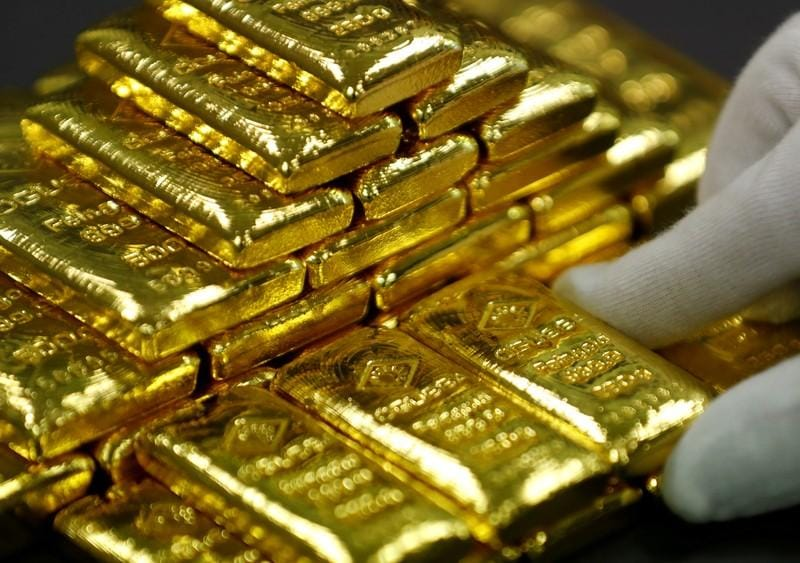 Gold slips as dollar firms ahead of Fed policy statement