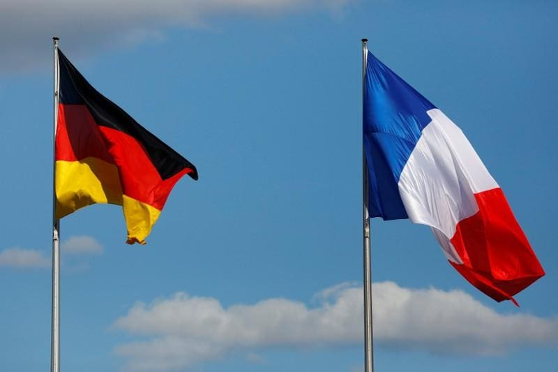 Leaders of France and Germany in poignant show of unity 100 years after WW1