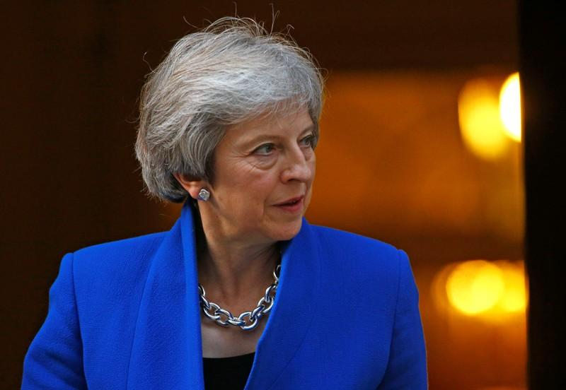 UK PM May says Brexit talks reaching their endgame, issues remain