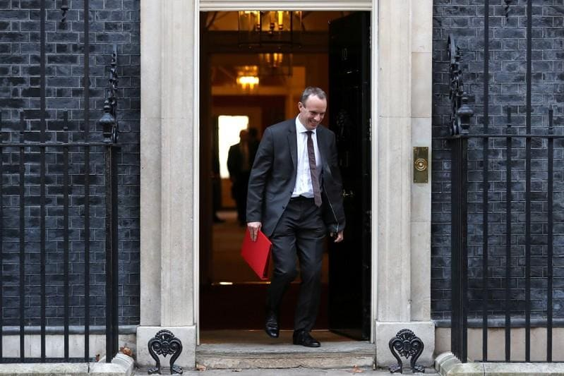 Highlights: UK ministers quit over draft Brexit deal, pound and bank stocks tumble