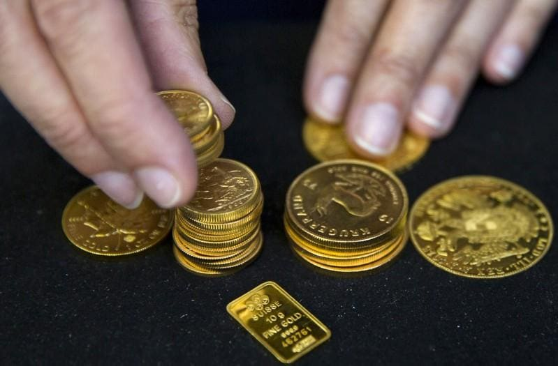 Gold jumps as dollar slides; palladium hits record high