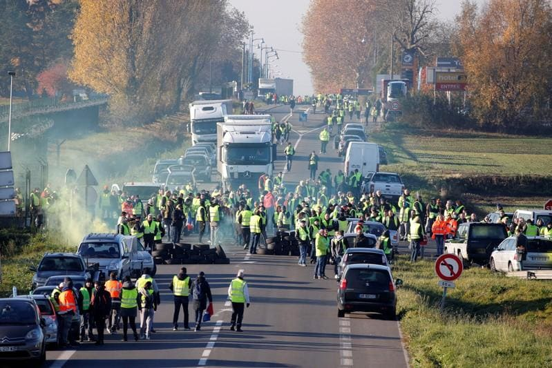 French protesters railing against Macron block roads