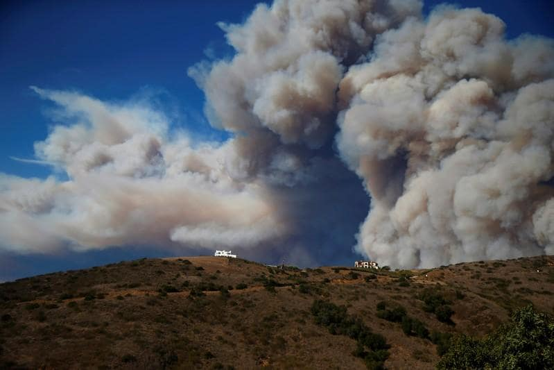 Rain looms as search for California wildfire missing continues