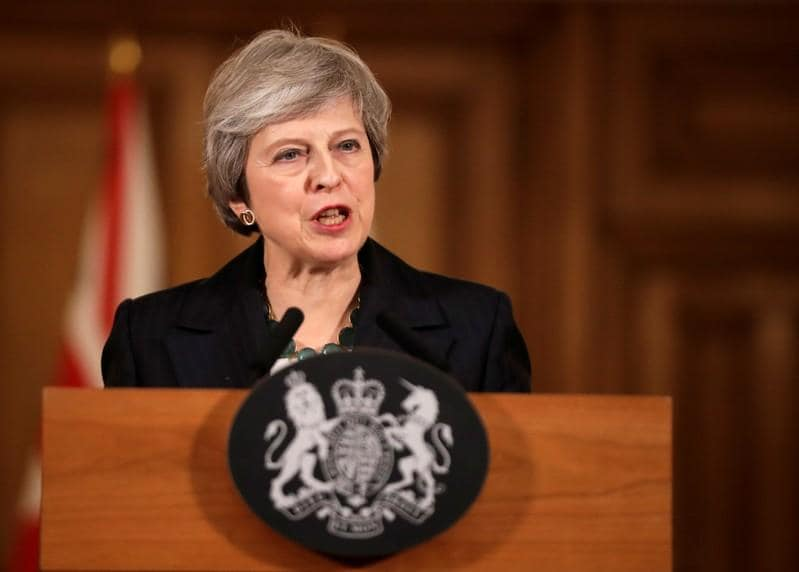 UK PM May sticks to Brexit deal as opponents seek formal challenge