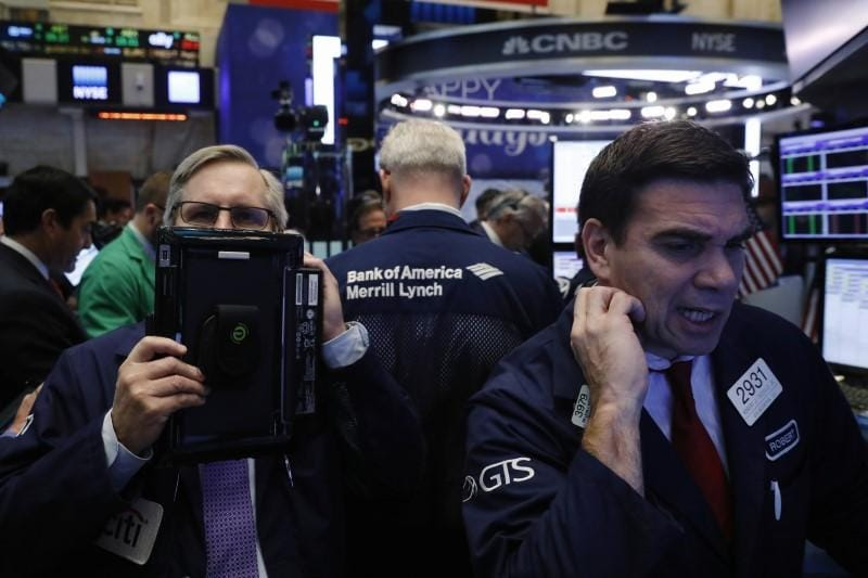 Stocks markets surge on hint of slower rate hikes