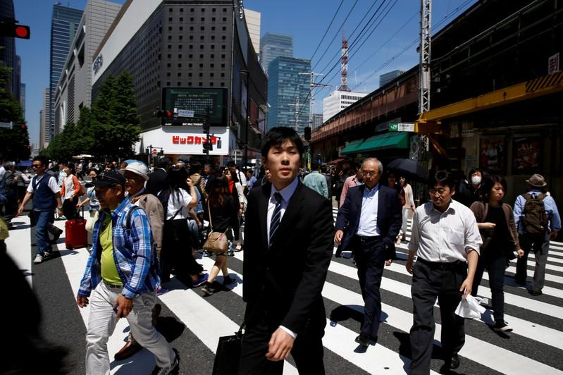Japans economy nearly stalls in third quarter growth at oneyear low as trade war bites