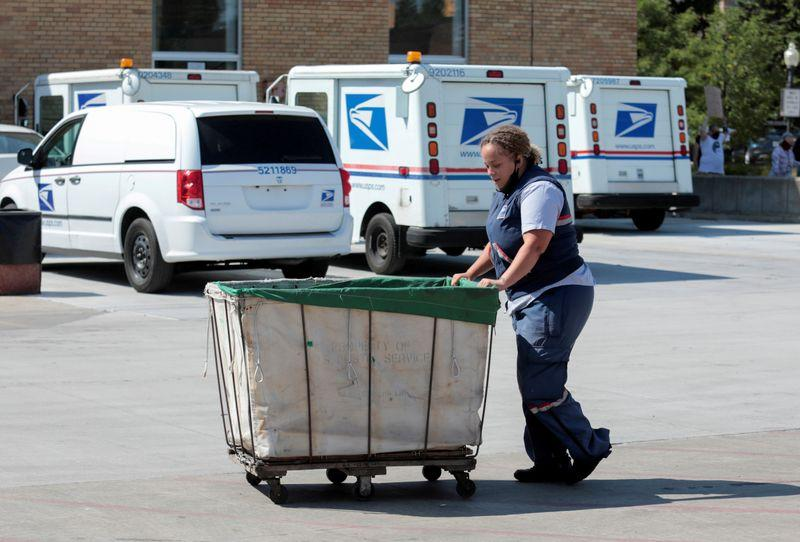 Judge says US postmaster must answer questions on delay in ballot sweep