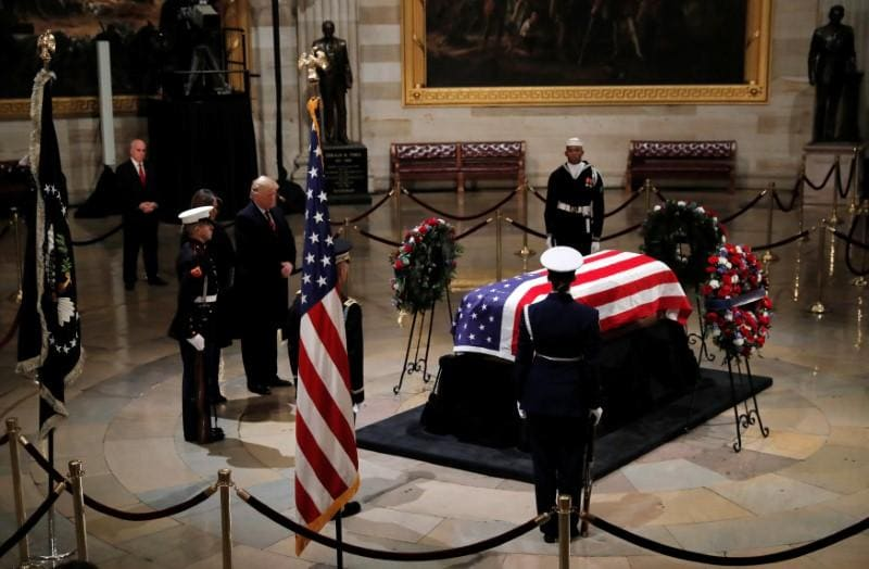 President George H.W. Bush's service dog Sully visits his casket