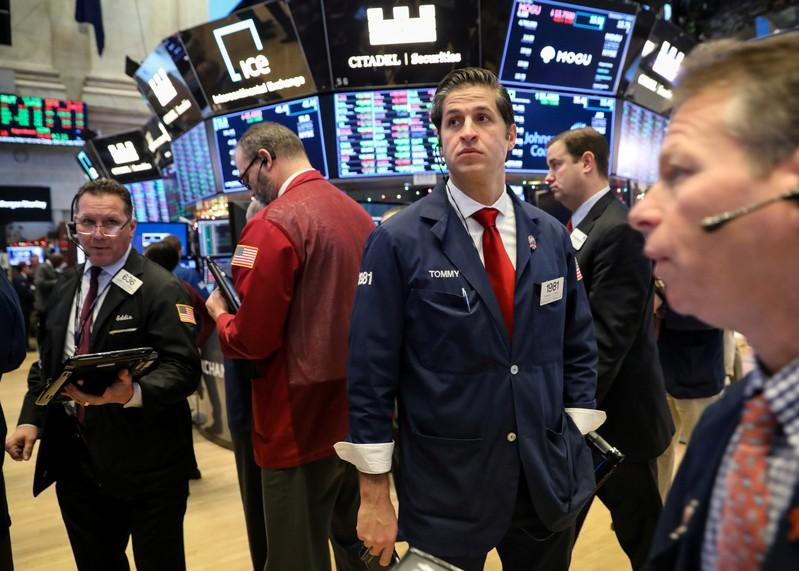 Global Markets: Shares mixed, Wall Street drops on trade worries; oil surges