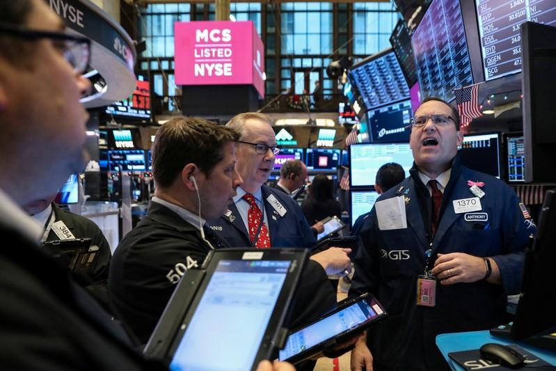 Wall Street tumbles on global growth worries, J&J decline