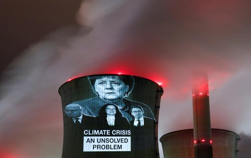 U.N. climate talks go into overtime as negotiators grapple with text