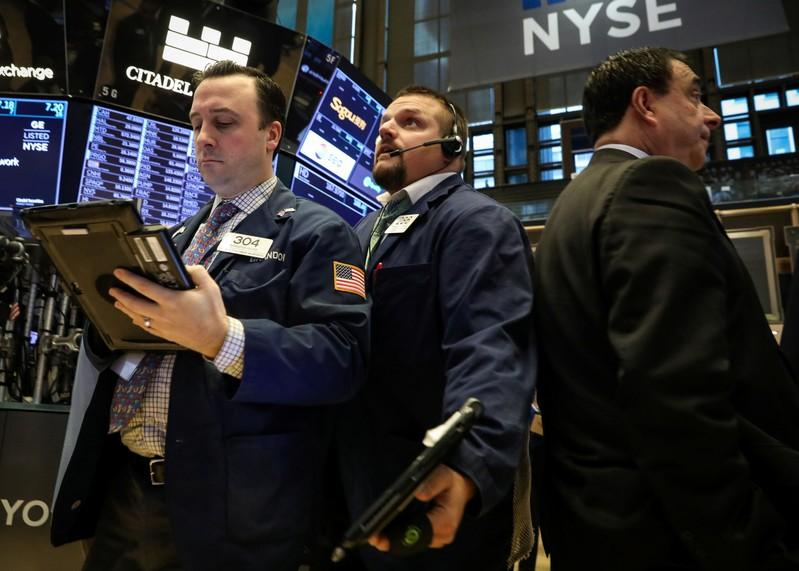 Wall St. propped up by tech stocks, financials rise ahead of Fed