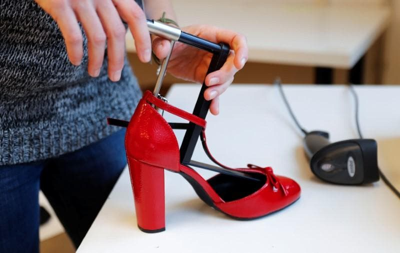 Focus: Online clothing retailers hunt for better fit to cut costly returns