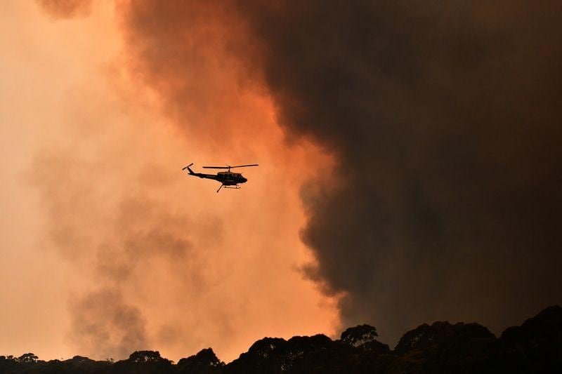 Two Australian firefighters die as flames circle Sydney prime minister cuts short holiday