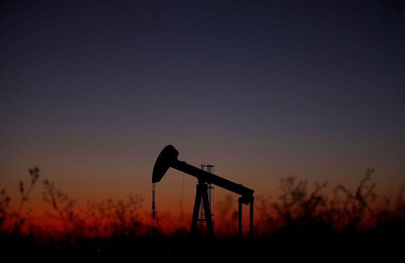 Oil prices down but log third weekly rise on trade hopes